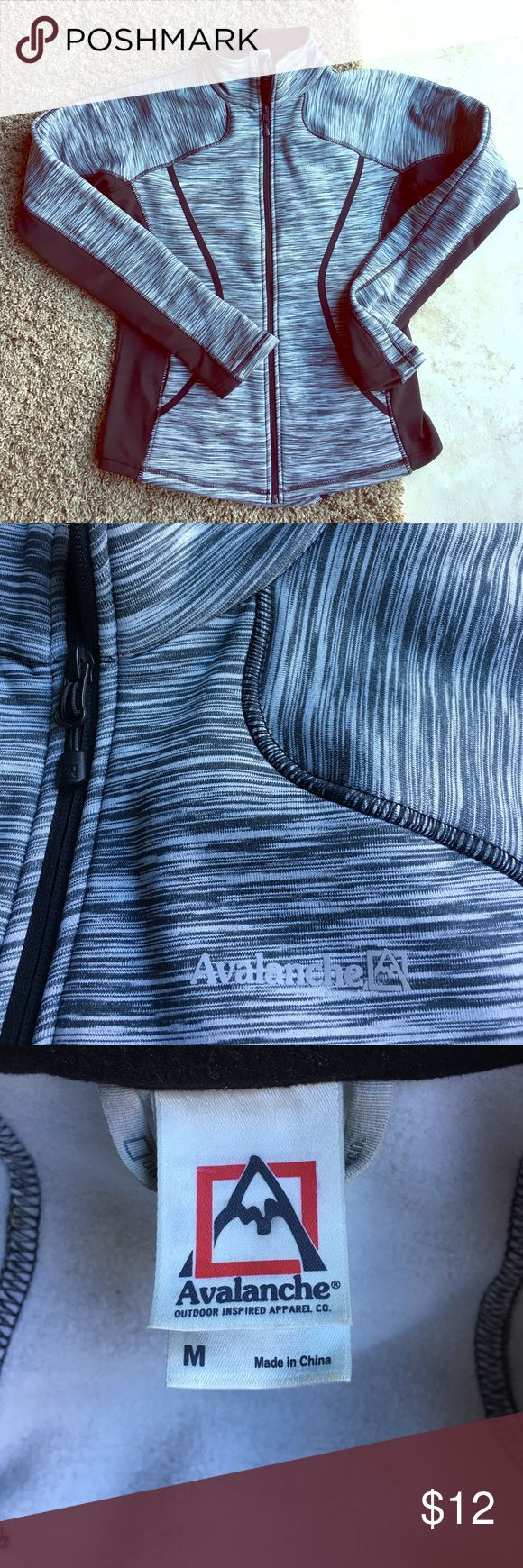 Black and White Zip up Avalanche Sweatshirt. Avalanche Black and White zip up sweatshirt.  Thumb holes at bottom of sleeves. Size Medium. Soft!  Only worn a couple of times. Cinching on the back makes it flattering. Avalanche  Tops Sweatshirts & Hoodies