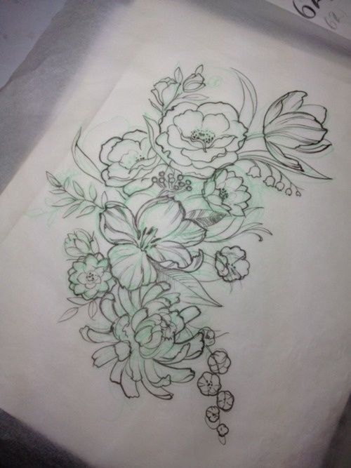 Beautiful combination of lovely flowers in this tattoo.