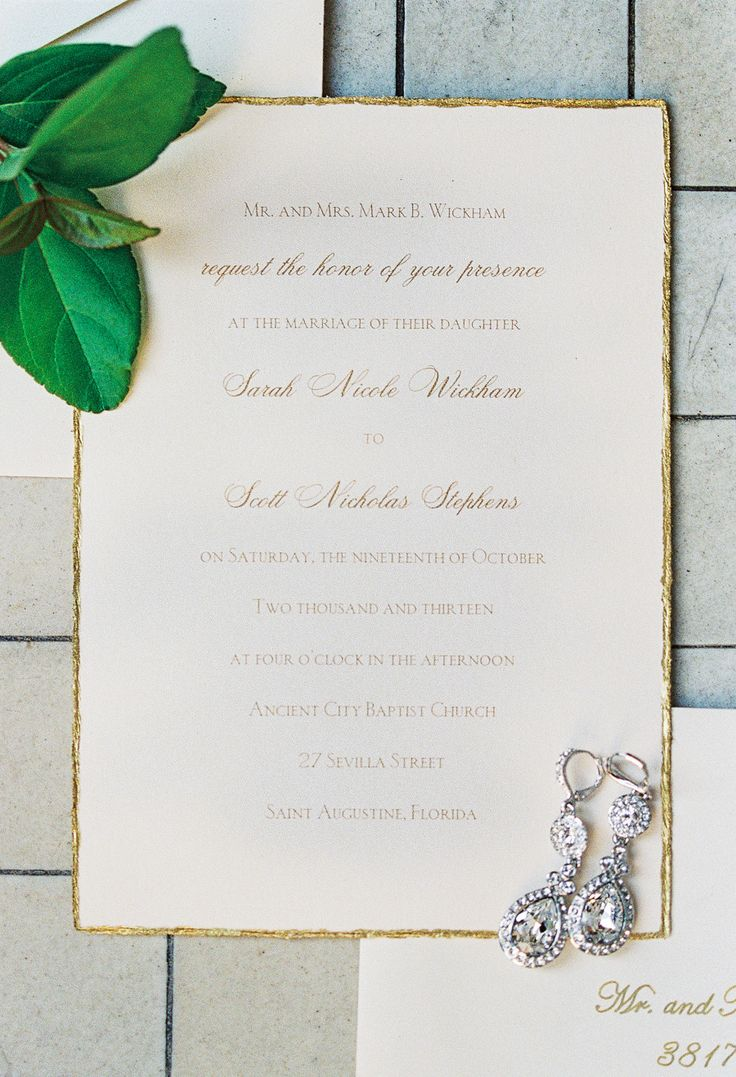 Gold-edged wedding invitations. See the wedding on SMP: http://www.StyleMePretty.com/southeast-weddings/2014/02/06/romantic-wedding-in-historic-st-augustine/ Jennifer Blair Photography