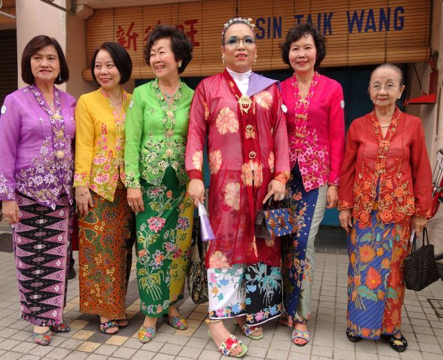 Peranakan women wearing baju kebaya and beaded shoes | Photo credit: manzrussali / Shutterstock.com