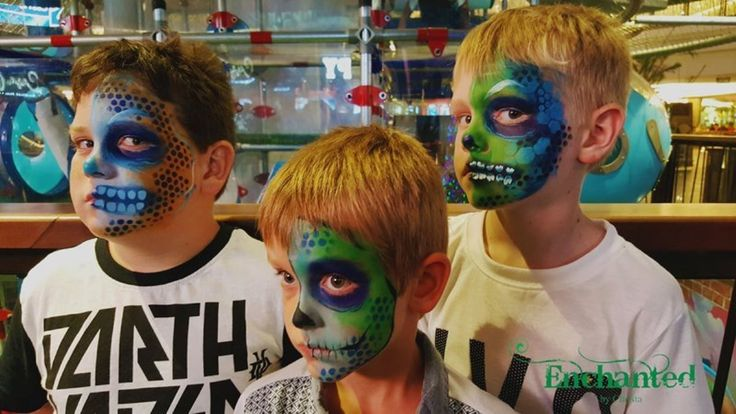 Half skull faces painted for boys at Sun City