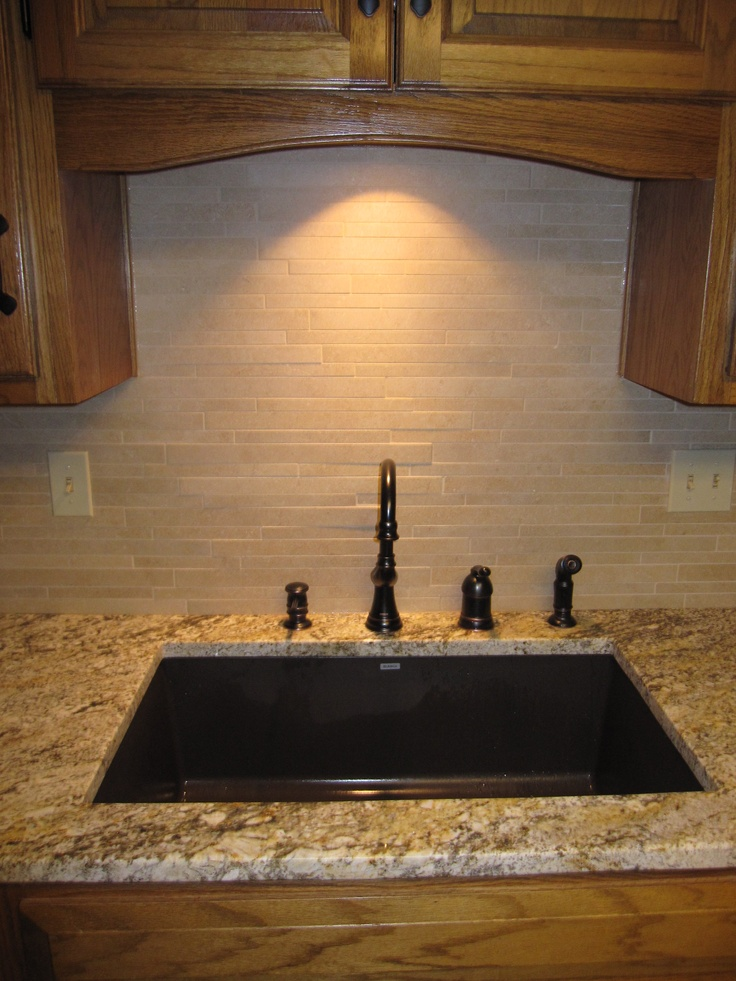 Composite Sink in kitchen, granite top, travertine backsplash and Moen ...