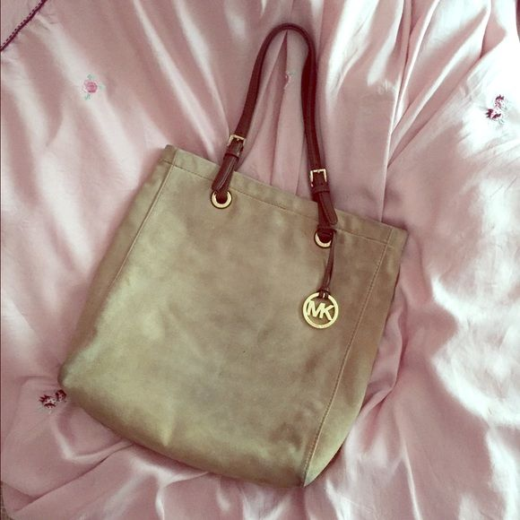 Michael Kors tote bag Mk bag just for viewing/trading! Suede tote bag in good used condition, wear on the bottom of bag. Gold hardware! Holds a lot. Michael Kors Bags