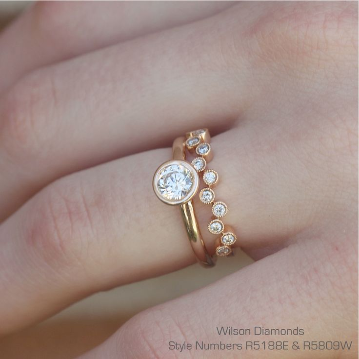 Classic bezel set solitaire with a fun bubble band! #wilsondiamonds #engagementring #rosegold #weddingset #ring