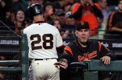 Aug 22, 2017; San Francisco, CA, USA; San Francisco Giants catcher Buster Posey (28) is greet at the dugout by Manager Bruce Bochy (15) after scoring a run in the second inning of their MLB baseball game with the Milwaukee Brewers at AT&T Park. Mandatory Credit: Lance Iversen-USA TODAY Sports