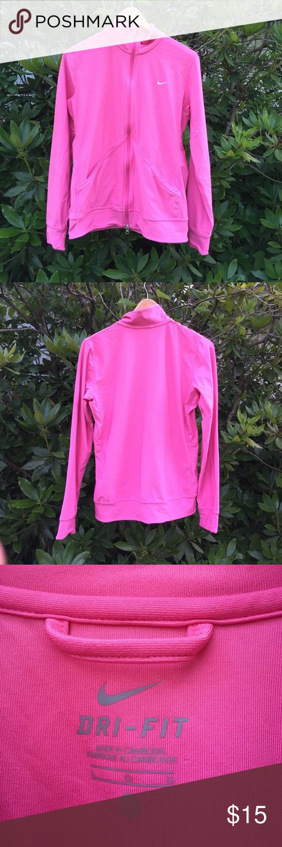 Nike Dri-fit womans pink workout zip up NIKE Dri-fit womans bright pink zip up workout top. Size large. Good used condition. Signs of wear may show. As-is. Great bright color. NIKE check embossed in white. Two front pockets. Long sleeves. Polyester spandex blend. Great top! Nike Tops Sweatshirts & Hoodies