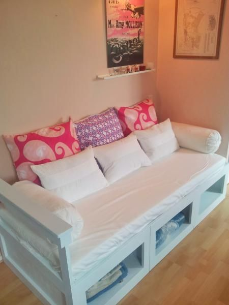 Buy/build a frame like this for the guest bed? Storage underneath can be used for linens, etc or left empty for the guests' use. It acts/looks like a couch when no one is sleeping in it.