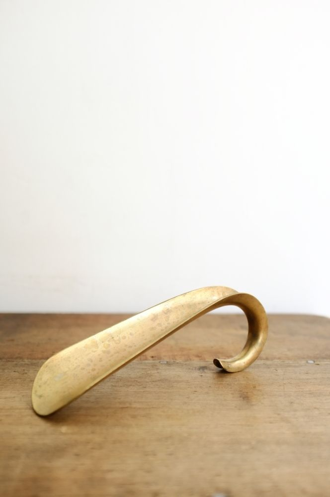 Image of Old brass shoehorn