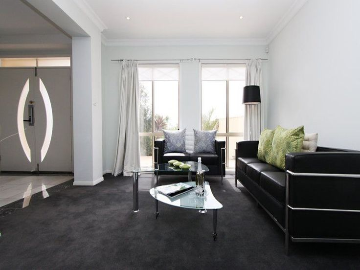 Dark carpet and sofa, accents of green