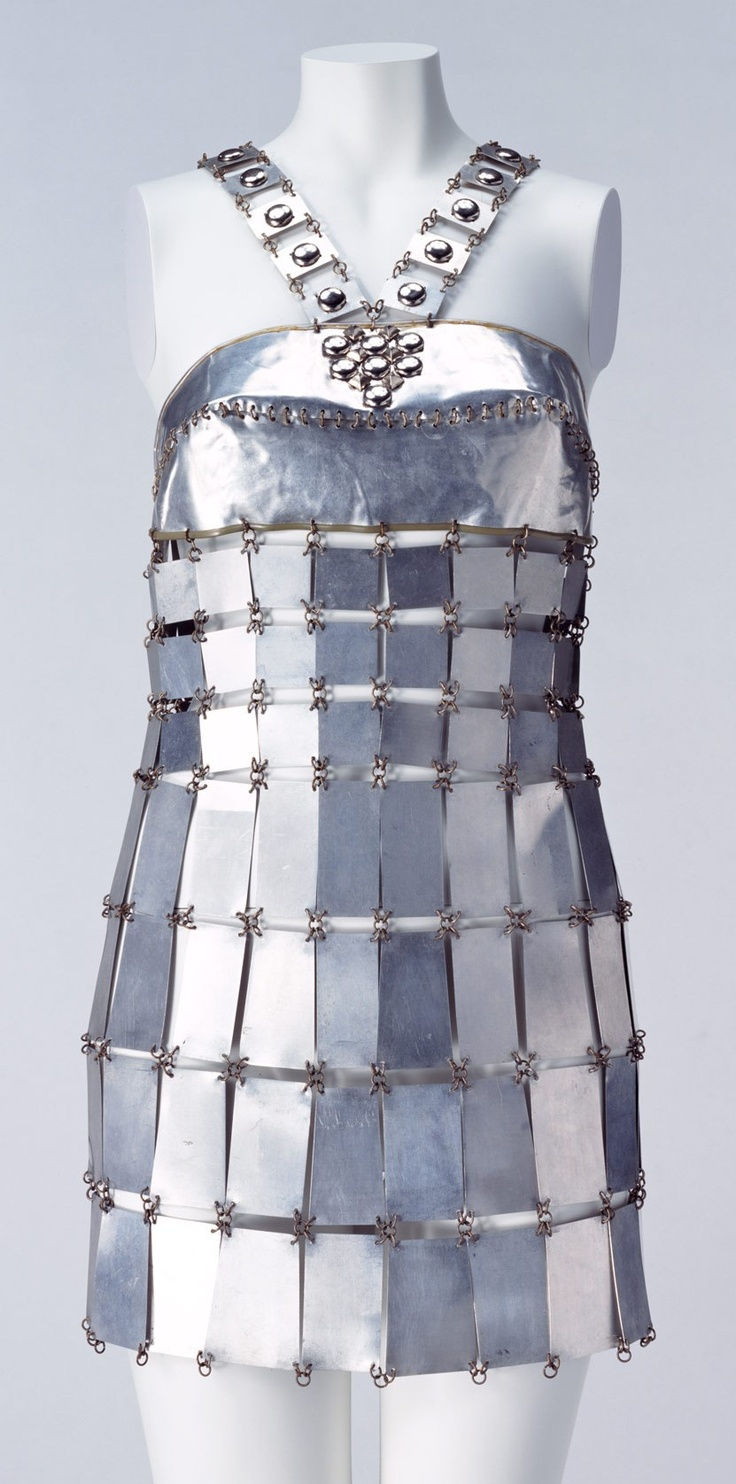"Mini Dress, Paco Rabanne: ca. 1967, aluminum plates and brass wire. ""This mini dress made of aluminum plates sums up work of Paco Rabanne, known as the ""Metal Worker."" The inorganic metal ""fabric"" makes a striking contrast against the skin. It is one of the monumental dresses of the 1960s, implicating of androids' glowing hard skin in science fiction..."""