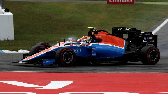 Pascal Wehrlein (GER) Manor Racing MRT05 and Rio Haryanto (IDN) Manor Racing MRT05 collide at the start of the race at Formula One…