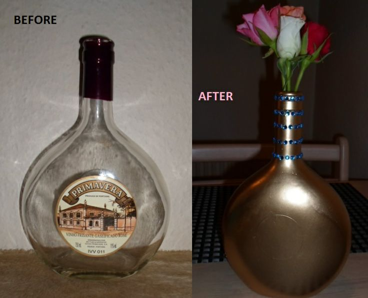 A winebottle made into a vase by using gold spraypaint and blue rhinestones.