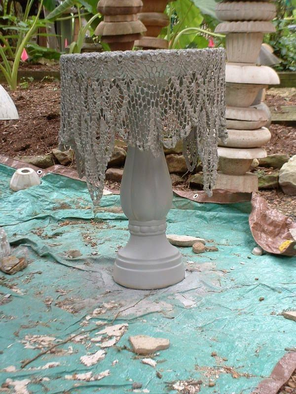 doily dipped in cement for bird bath