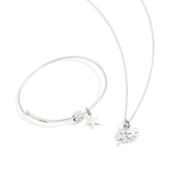 White is a must-have this winter!  Discover Dodo Starfish and Four Leaf Clover charm in white gold.
