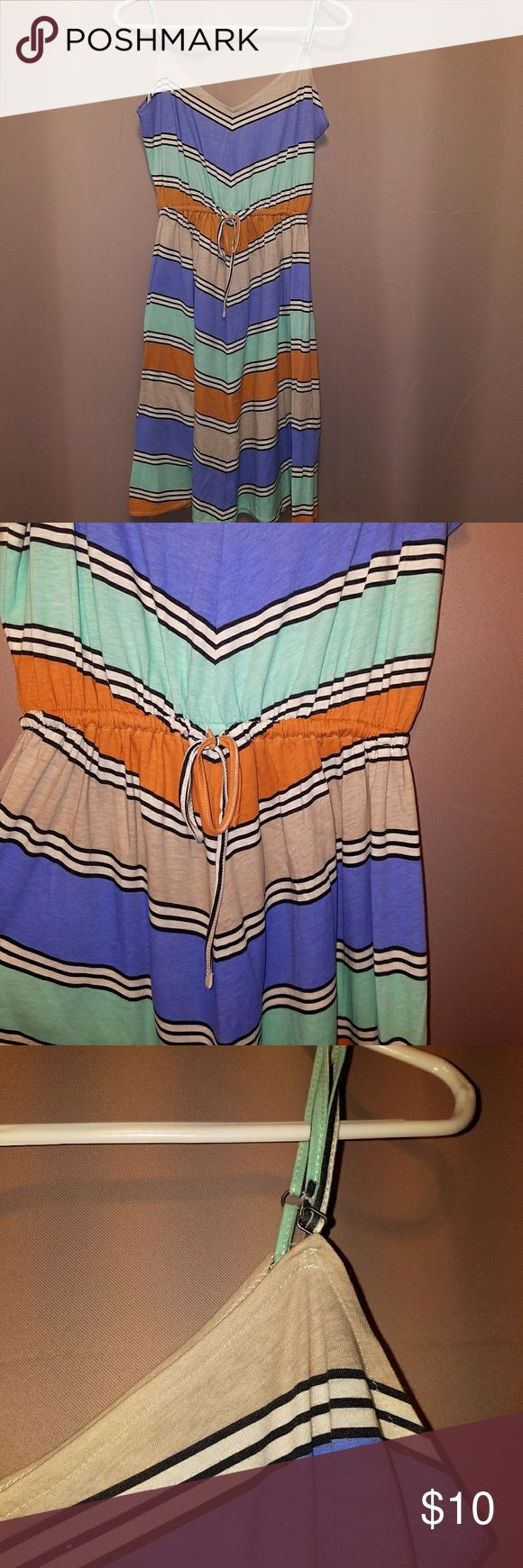 Beat the heat in style! My favorite summer activity in Chicago is the festivals!  Perfect festival dress!  Pair with comfortable sandals and eat, drink, and be merry in this flowy frock!  Chevron pattern with blue, teal, orange, black, and white.  Adjustable spaghetti straps and tie waist. O'Neill Dresses Midi