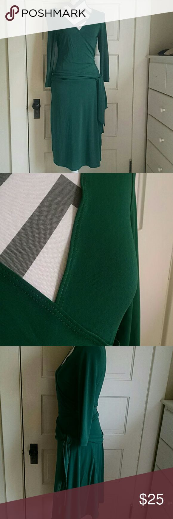 """Bcbg maxazaria surplus faux wrap dress M BCBGMAXAZARIA emerald green faux wrap surplus dress. Comes just below knee on me 5,3"""". Material has a nice weight to it. Attached wide waist belt. The V neck is open and can be adjusted and pinned depending how much skin you prefer to show. Worn once with a lace cami underneath. Just beautiful with some leggings and boots with this in between weather!! Size M. Perfect for St. Patrick's day date!!! BCBGMaxAzria Dresses Midi"""