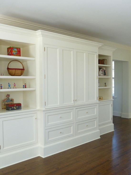 Traditional Media Room Built-in Bookshelves. Love the folding doors hiding the TV