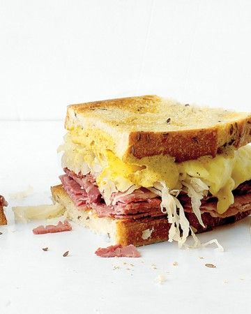 Deli Reuben Sandwich - Spicy brown mustard replaces the usual Russian dressing in this easy version of a classic deli sandwich. Layer corned beef, sauerkraut, and Swiss cheese on toasted, buttered rye bread and bake until the cheese melts. Serve with pickles on the side.