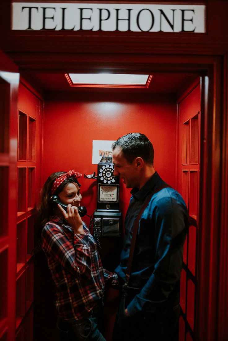 Couple inside the phone booth