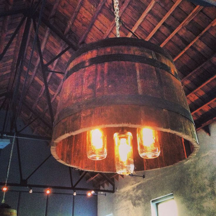 Whiskey barrel chandelier with Edison bulb mason jars.