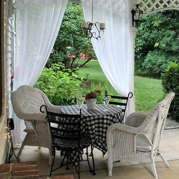 dining furniture on patio with curtains