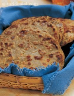An interesting mix of spices perks up the taste of bajra in these famous rajasthani style rotis. While potatoes are used to help better bind the flour, be careful when you roll out the rotis so that they do not break.