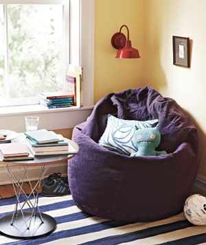 Transform a corner of your home into a kids' reading nook. All you really need is a big comfy chair and a few accessories.