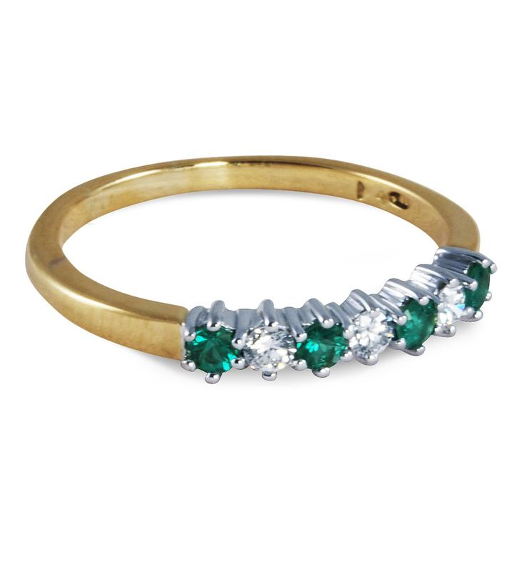 Emerald & Diamond Anniversary band with 0.15 carat total weight in diamonds.