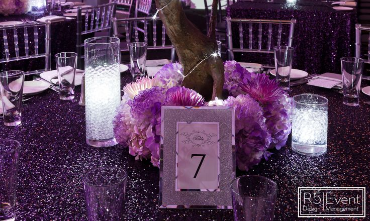 Its all in the details! Purple sequin table cloth, custom seating frame, a base of illuminated florals & glowing vases by R5 Event Design