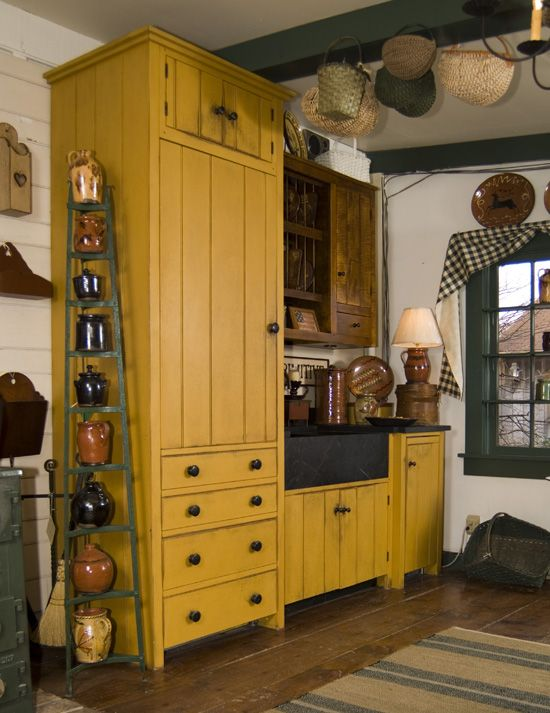 Prim Farmhouse Kitchen...with mustard cupboards and crocks.