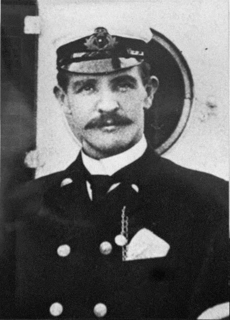 Titanic's First Officer William McMaster Murdoch, who is treated as a local hero in his native town of Dalbeattie, Scotland, but was portrayed as a coward and a murderer in the multi-Oscar winning movie, Titanic. At a ceremony on the 86th anniversary of the ship's sinking, Scott Neeson, the executive vice-president of the film's makers 20th Century Fox, presented a check for five thousand pounds ($8,000 US dollars) to the Dalbeattie school as an apology to the bridge officer's relatives