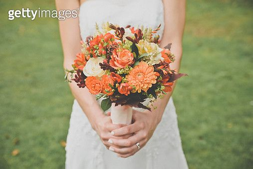 Bride holding bouquet, cropped - gettyimageskorea