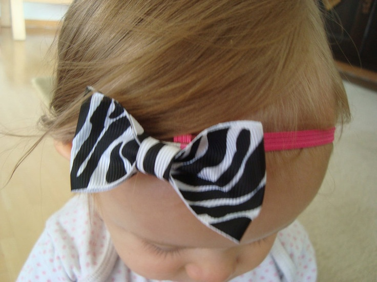 Skinny ( 1/4 inch) comfortable stretchy hot pink elastic headband with a  super sweet black and white zebra bow. bow measures about 2.5 inches.    Can
