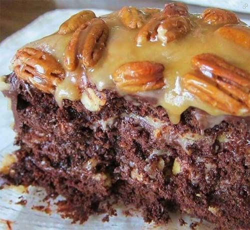 This German chocolate turtle cake is filled with a creamy caramel layer, chocolate chips and pecans. This cake is outstanding in taste and is super easy to make.