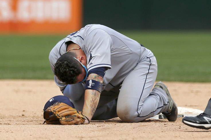 Tampa Bay Rays shortstop Asdrubal Cabrera kneels on the ground after being hit in the head on a throw from catcher Curt Casali during the 10th inning. Cabrera stayed in the game. THE ASSOCIATED PRESS