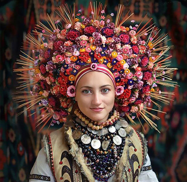 A Slavic workshop of stylists and photographers called Treti Pivni have decided to bring back one of the more amazing Ukranian traditions by giving it a new meaning. They've produced a portrait series of modern Ukranian women dressed in traditional Ukranian floral headdresses.
