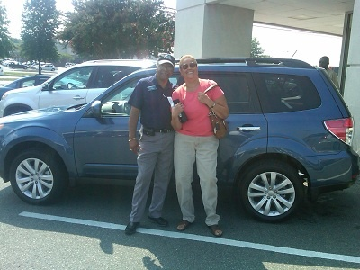 Folger Subaru Sales Consultant Bill Barber with Mrs. Mock and her new 2011 Subaru Forester SUV!