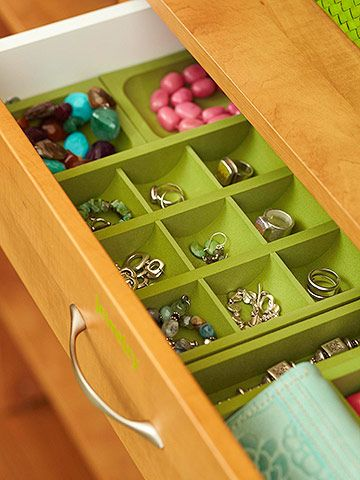 Jewelry Drawer Organizers  Jewelry and other accessories remain untangled and tidy thanks to drawer organizers. There's even enough room left to stash small clutch purses in the drawer.