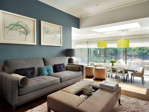 Если у вас объединены кухня/столовая и гостиная. Стены цвета пыльной морской волны, серая мебель, фиолетовы/желтые/песочные акценты.