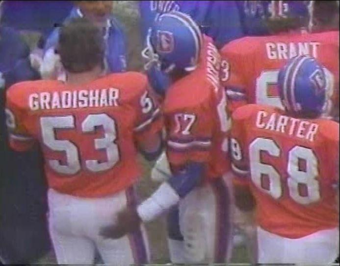 Linebackers RANDY GRADISHAR (53) and TOM JACKSON (57) with defensive linemen RUBIN CARTER (68) and JOHN GRANT (63)--November 4, 1979