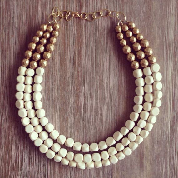 our most popular necklace ever is now available in an array of great colors!!    White painted wood beads are strung with Matte Gold Czech Glass