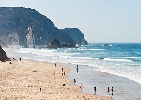 Insider Guide to Portugal's Southern Coast -  	Intelligent Travel - National Geographic Traveler - Posted by Janelle Nanos in Beyond the Guidebook on September 4, 2014  Portugal is made for wanderers. Surf camps dot the 215-mile stretch south of the storied capital city. Part of the region known as the Alentejo, this shore is far quieter than the Algarve beaches at the country's southern edge.   Photograph of beachgoers - Sagres, Portugal