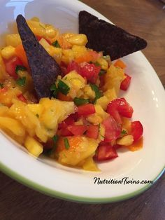 Pineapple-Mango Salsa   Only  76 Calories for BIG portion  Zesty, Refreshing   Bromelain in pineapple aids digestion, helps prevent bloating  For Nutrition & FitnessTips & MORE RECIPES, PLEASE SIGN UP for our FREE NEWSLETTER www.NutritionTwins.com