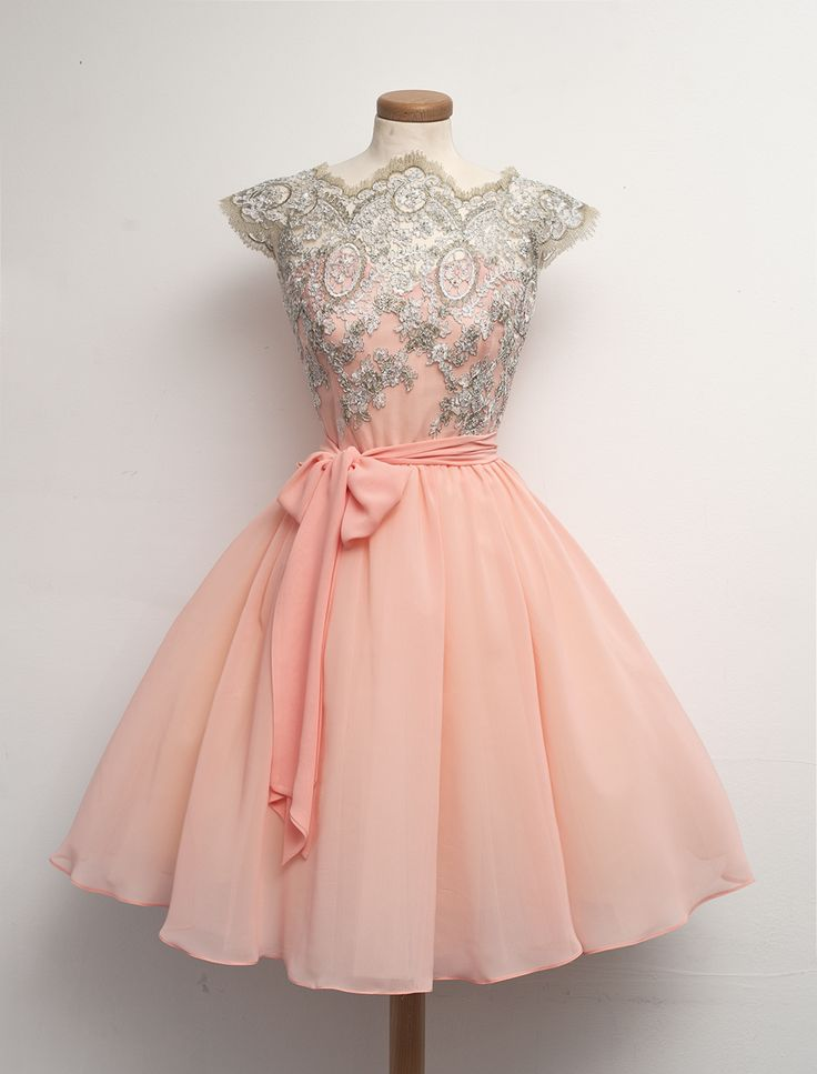 Pink Florescent dress with silver flower designs on the top and plain pink bottom