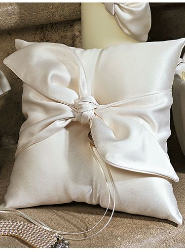 Have your rings carried down the aisle with style with our elegant Love Knot ring pillow.  A matte satin bow tied in a dramatic knot is the crowning touch to this chic ring pillow.Available in white or ivory.