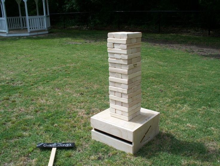 Giant Jenga (Jenga XXL) is an outdoor wedding game that is used in many weddings at 1899 Farmhouse outdoor wedding venue. See more games at https://1899farmhouse.com/popular-outdoor-wedding-games/