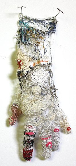"[a cast of my left hand in the shape of a] Glove v. 3, 10"" x 5"" x 2"", thread, hair, found trimmings and pins, 2008 > NAVA LUBELSKI: artworks"
