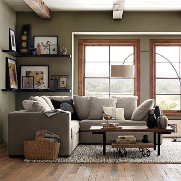 J: LOVE!  Love the corner shelving, the basket, the pillows, (the lamp), and the wall color with brown and white accents near the windows.
