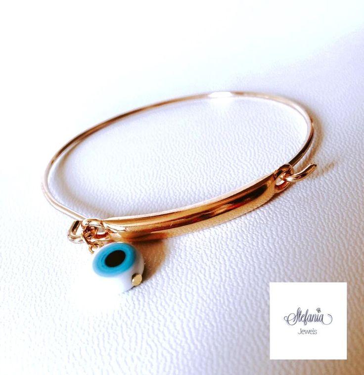 Bangle bracelets. Evil eye bracelets. Gold plated bracelets. Gold bangle bracelets by StefaniaJewelsShop on Etsy