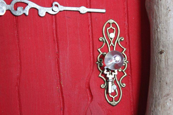 Ladybug red fairy door, doorknob